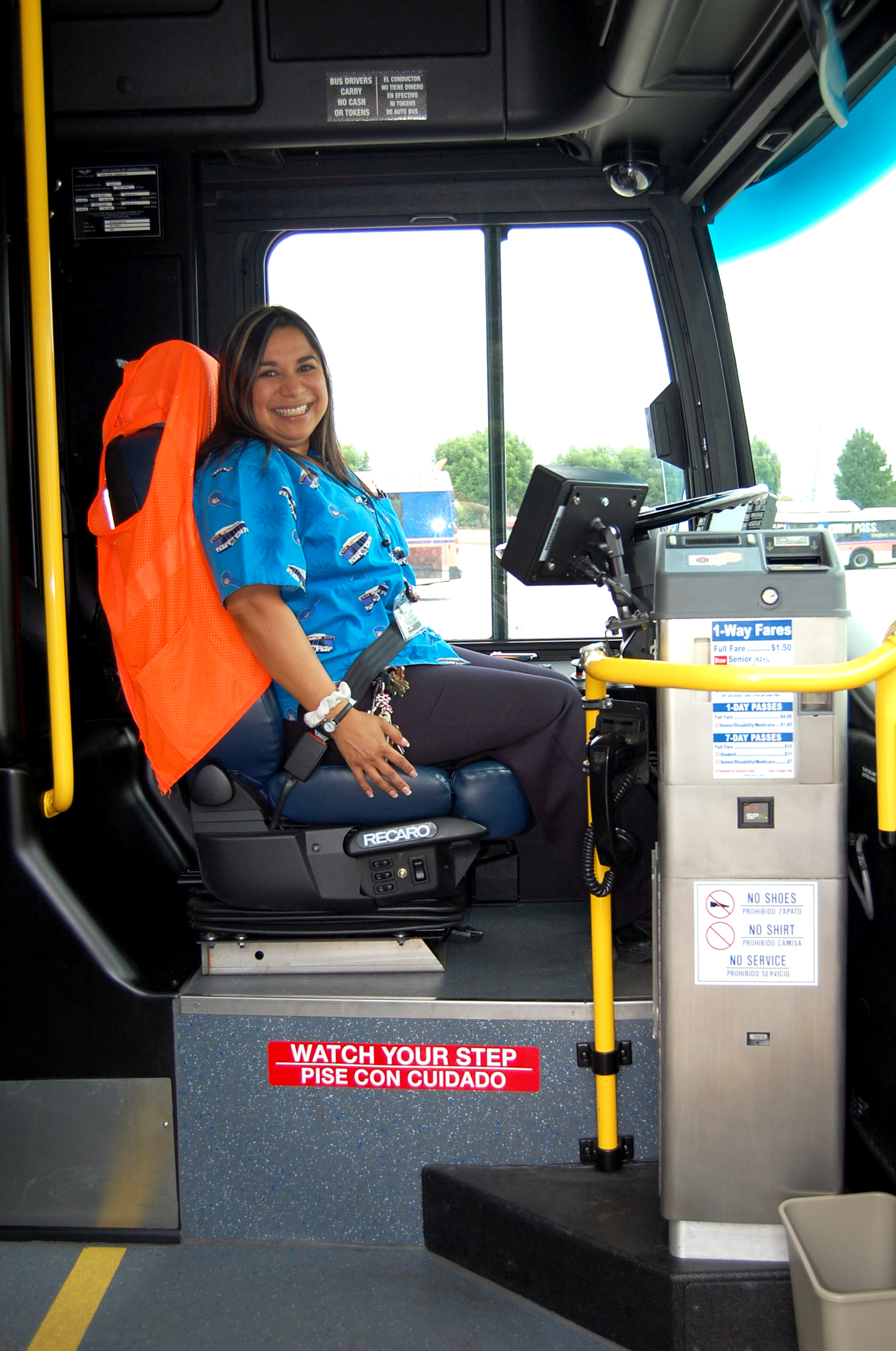 Driver welcomes passenger aboard the Omnitrans New Flyer Xcelsior bus